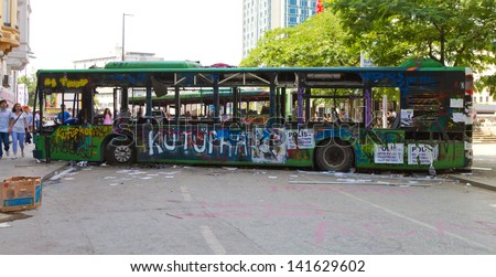 ISTANBUL - JUNE 08: Barricade by bus around Taksim Square during protests on June 08, 2013 in Istanbul, Turkey. People do not allow police to enter Taksim Square before their requests are accepted. - stock photo