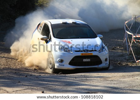 ISTANBUL - JUNE 10: Eytan Halfon drives a Ford Fiesta R2 car during 33th Istanbul Rally championship, Yesilvadi Stage on June 10, 2012 in Istanbul, Turkey. - stock photo