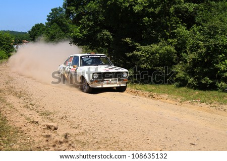 ISTANBUL - JUNE 10: Kemal Gamgam drives a Ford Escort MK2 car during 33th Istanbul Rally championship, ISG Stage on June 10, 2012 in Istanbul, Turkey. - stock photo