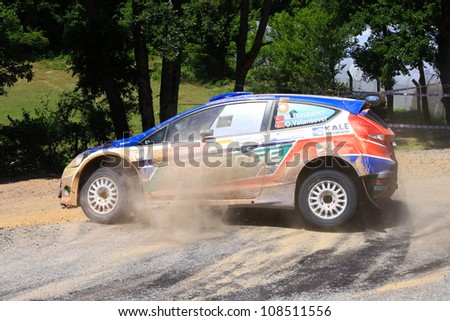 ISTANBUL - JUNE 10: Murat Bostanci drives a Castrol Ford Team Turkiye Ford Fiesta S2000 car during 33th Istanbul Rally championship, ISG Stage on June 10, 2012 in Istanbul, Turkey. - stock photo