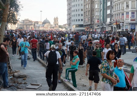 ISTANBUL - JUNE 01 2013 : People are at Taksim Square to protest against Taksim Gezi Park demolition in Istanbul, Turkey. Protests developed into anti-government demonstrations and occupying Gezi Park - stock photo