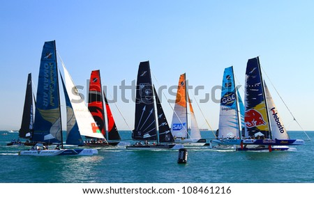 ISTANBUL - JUNE 09: Unidentified participants compete in the Extreme Sailing Series boat race on June 09, 2012 in Istanbul, Turkey. - stock photo