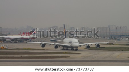 ISTANBUL - MARCH 19: Airbus A380 taxiing on runway at Istanbul Ataturk Airport on March 19, 2011 in Istanbul, Turkey. Lufthansa's Airbus A380 has landed to Istanbul for an advertising flight. - stock photo