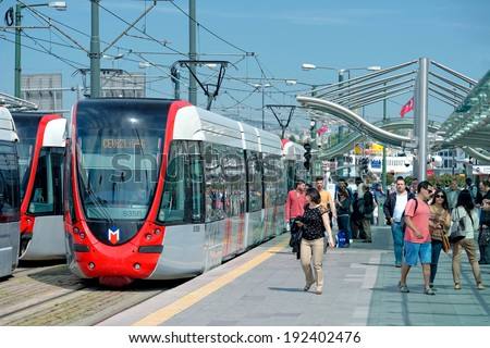 ISTANBUL - MAY 12: A modern tram on Sirkeci on May 12, 2014 in Istanbul. Due to increasing traffic & air pollution, Istanbul became one of most polluted city also planned for return of tram.  - stock photo