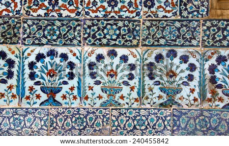 ISTANBUL - MAY 18, 2014 -   Iznik lapis  tiles with tulip pattern on a wall  Courtyard of the Favorites Harem of  Topkapi Palace, in Istanbul, Turkey - stock photo