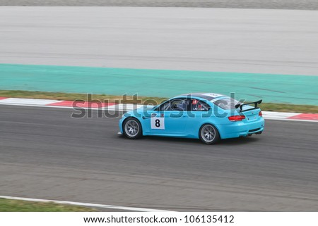 ISTANBUL - MAY 12: Levent Kocabiyik drives a Maxi class BMW M3 GT4 car during 2012 Turkish Touring Car Championship, Istanbul Park on May 12, 2012 in Istanbul, Turkey. - stock photo