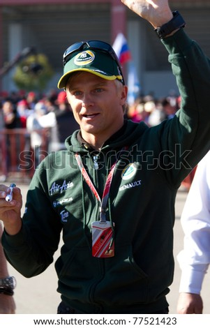 ISTANBUL - MAY 07: Lotus Renault team driver Heikki Kovalainen greets fans during 2011 F1 Turkish Grand Prix, Istanbul Park on May 07, 2011 Istanbul, Turkey. - stock photo