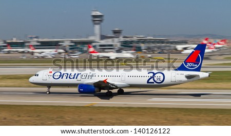 ISTANBUL - MAY 26: Onur Air Airbus A321-131 accelerate to takeoff at Ataturk Airport on May 26, 2013 in Istanbul, Turkey. Onur Air was established on 1992 and has 34 Airbus aircrafts on May 2013. - stock photo