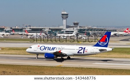 ISTANBUL - MAY 26: Onur Air Airbus A320-232 accelerate to takeoff at Ataturk Airport on May 26, 2013 in Istanbul, Turkey. Airbus A320 introduced in 1988, has 180 maximum seating capacity. - stock photo