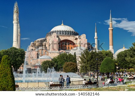 ISTANBUL - MAY 24, 2013: Tourists visiting the Hagia Sophia on may 24, 2013 in Istanbul, Turkey. Hagia Sophia is the greatest monument of Byzantine Culture. - stock photo