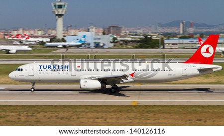 ISTANBUL - MAY 26: Turkish Airlines Airbus A321-231 accelerate to takeoff at Ataturk Airport on May 26, 2013 in Istanbul, Turkey. TA has 219 aircraft fleet with 227 scheduled destinations on May 2013. - stock photo