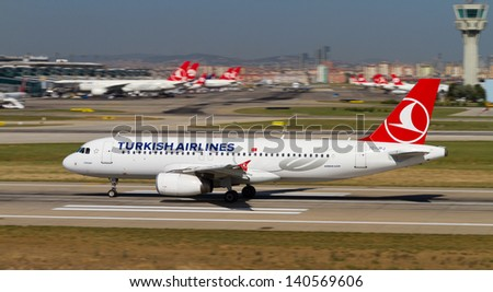 ISTANBUL - MAY 26: Turkish Airlines Airbus A320-232 accelerate to takeoff at Ataturk Airport on May 26, 2013 in Istanbul, Turkey. TA is the national flag carrier airline of Turkey. - stock photo