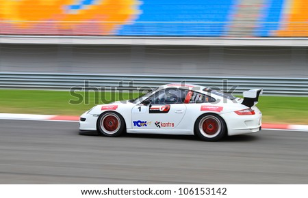 ISTANBUL - MAY 13: Yadel Oskan drives a Porsche 997 GT3 car during 2nd race of 2012 Vizio GT3 Challence, Istanbul Park on May 13, 2012 in Istanbul, Turkey. - stock photo