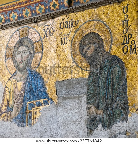 ISTANBUL, NOV 14: Ancient Deesis Mosaic of Jesus Christ (known as Christ Pantocrator) flanked by John the Baptist in the Hagia Sophia museum. November 14, 2013 in Istanbul, Turkey  - stock photo