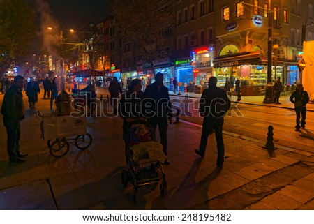 ISTANBUL - NOV 20: Street view with people silhouettes and food wagons on november 20, 2013 in Istanbul, Turkey. - stock photo