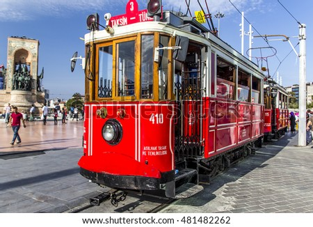 ISTANBUL - SEPTEMBER 10 : Taksim Istiklal Street at eventide on September 10, 2016 in Istanbul, Turkey. Taksim Istiklal Street is a popular tourist destination there is red tramvay on Taksim square.