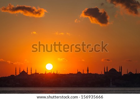 Istanbul silhouette. Blue Mosque and Hagia Sophia at sunset. - stock photo