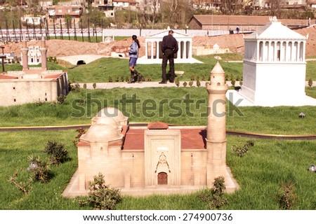 ISTANBUL, TURKEY - APRIL 30: Alaaddin Mosque of Nigde at the Miniaturk miniature park on Golden Horn on April 30, 2005 in Istanbul, Turkey. Miniaturk is one of the world's largest miniature parks. - stock photo
