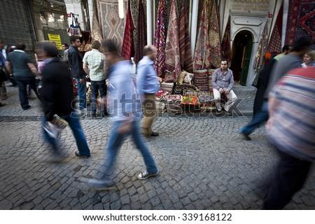 ISTANBUL, TURKEY APRIL 26: Carpet merchant outside the Grand Bazaar in Istanbul on alleyway with tourists and local Turkish people prior to Anzac Day on April 26, 2012 in Istanbul, Turkey.  - stock photo