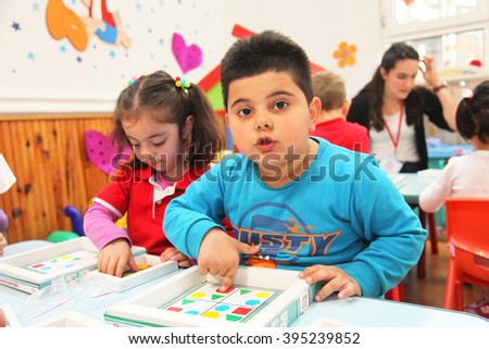 ISTANBUL, TURKEY - APRIL 4: Children learning intelligence games in kindergarten school on April 4, 2014 in Istanbul, Turkey. - stock photo