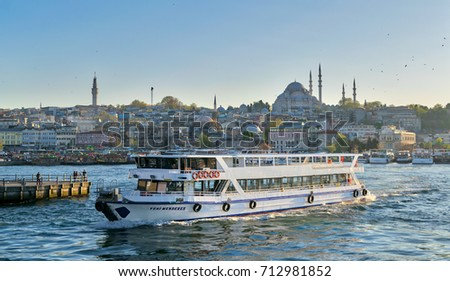 Istanbul, Turkey - April 25, 2017: City view of Istanbul, Turkey from the sea overlooking a passing ferry with Eminonu district and Sulaymaniye Mosque in the background