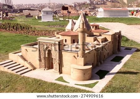 ISTANBUL, TURKEY - APRIL 30: Divrigi Ulu Mosque of Sivas at the Miniaturk miniature park on Golden Horn on April 30, 2005 in Istanbul, Turkey. Miniaturk is one of the world's largest miniature parks. - stock photo