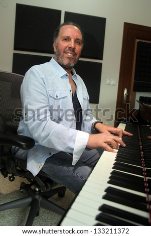 ISTANBUL, TURKEY - APRIL 18: Famous Turkish musician and singer Fatih Erkoc at own album promotion press meeting on April 18, 2012 in Istanbul, Turkey. - stock photo