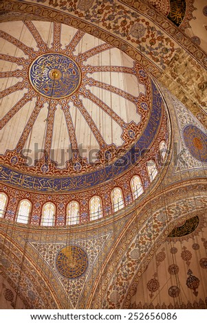 Istanbul, Turkey - April 28, 2013:Interior decoration of the dome of Blue Mosque.The Mosque was built from 1609 to 1616, during the rule of Sultan Ahmed I.  - stock photo