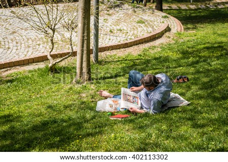 Istanbul, Turkey - April 06, 2016: Man is reading news paper in Macka park in Istanbul, Turkey