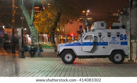 Istanbul, Turkey - April 9, 2016: Police armored vehicle on night street of Istanbul, Turkey. Photo taken with long exposure. - stock photo