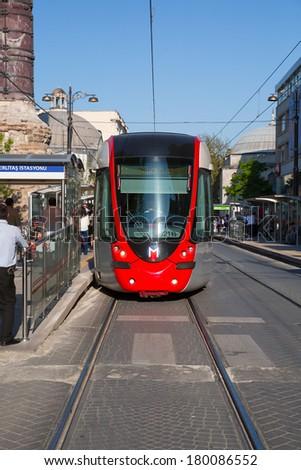 ISTANBUL - TURKEY - APRIL 27 : Public transport in Istanbul, modern tram trains meeting in Sultanahmet district on cobbleroad, April 27, in Istanbul, Turkey 2013  - stock photo