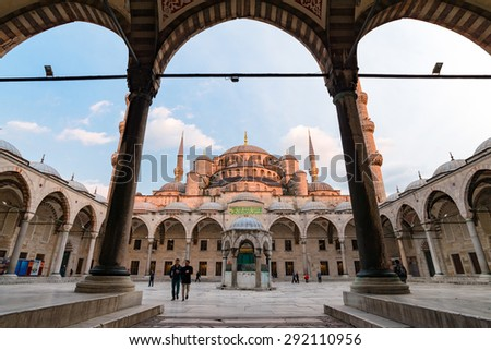 ISTANBUL, TURKEY - APRIL 08, 2015: Tourists visit Blue Mosque on April 08, 2015 in Istanbul. It was built from 1609 to 1616, during the rule of Sultan Ahmed I. Sultanahmet Square and Blue Mosque - stock photo