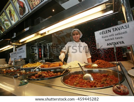 ISTANBUL, TURKEY - APRIL 27: Turkish chef serving famous Turkish traditional meals in the Ottoman Restaurant on April 27, 2010 in Istanbul, Turkey.