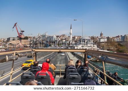 ISTANBUL, TURKEY - APRIL 11, 2015: view of a sightseeing bus in Istanbul with unidentified people. Istanbul is the largest city in Turkey and a famous travel destination  - stock photo