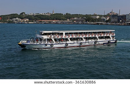 ISTANBUL, TURKEY - AUGUST 09, 2015: A ferry in the Golden Horn with Tokapi Palace and the Hagia Sofia in the background. - stock photo