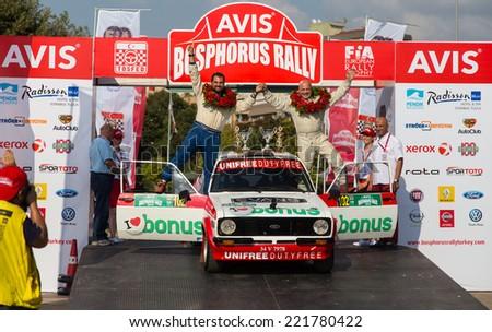 ISTANBUL, TURKEY - AUGUST 17, 2014: Engin Kap with Ford Escort MKII car of Bonus Unifree Parkur Racing Team in Podium Ceremony of Avis Bosphorus Rally - stock photo