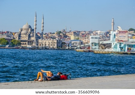 ISTANBUL, TURKEY, AUGUST 22, 2014: Family is relaxing on promenade at beyoglu in istanbul. - stock photo