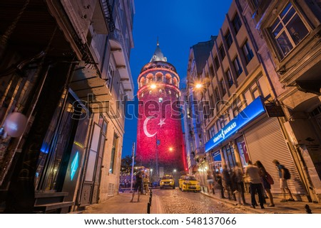 ISTANBUL, TURKEY - AUGUST 6, 2016: Istanbul's historic Galata Tower lights up with colors of Turkish flag. Turkish Flag light show on the Galata Tower. Istanbul, Turkey.