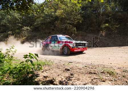 ISTANBUL, TURKEY - AUGUST 16, 2014: Kerem Ustunkaya drives Ford Escort MKII car of Bonus Unifree Parkur Racing Team in Avis Bosphorus Rally, Deniz Stage
