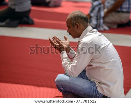 ISTANBUL, TURKEY - AUGUST 02: Muslim man praying after Friday prayers on August 02, 2013 in Istanbul, Turkey. Eyup Sultan Mosque is one of the most visited places in Istanbul. - stock photo