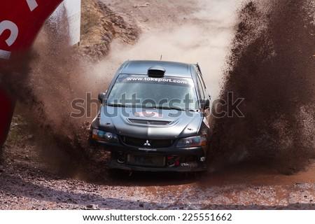 ISTANBUL, TURKEY - AUGUST 17, 2014: Nebil Erbil drives Mitsubishi Lancer Evo IX car of Tok Sport WRT in Avis Bosphorus Rally, Gocbeyli Stage - stock photo