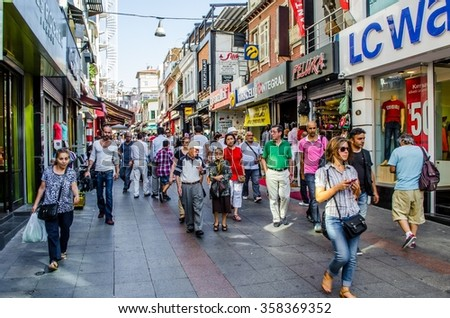 ISTANBUL, TURKEY, AUGUST 21, 2014: Ordinary streets of asian part of istanbul are during the day swiftly changed into marketplace with various items to buy. - stock photo