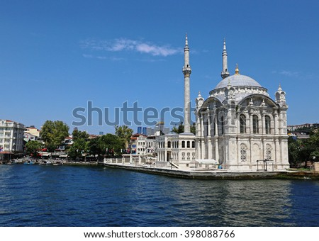 ISTANBUL, TURKEY - AUGUST 14, 2015: Ortakay Mosque shot  from the Bosphorus.  It was completed in 1856.  - stock photo