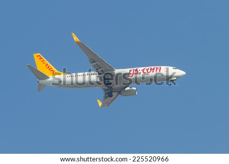 ISTANBUL, TURKEY - AUGUST 16, 2014: Pegasus Airlines Boeing 737-800 landing to Sabiha Gokcen Airport. Pegasus is the second largest airlines in Turkey with 54 airplanes. - stock photo
