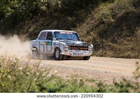 ISTANBUL, TURKEY - AUGUST 16, 2014: Timur Ozkan drives Fiat 124 car in Avis Bosphorus Rally, Deniz Stage
