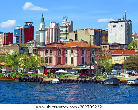 ISTANBUL, TURKEY -- CIRCA APRIL 2014: New and old building on the banks of the Bosphorus. Mooring boats left from the ferries Karakoy.                                - stock photo
