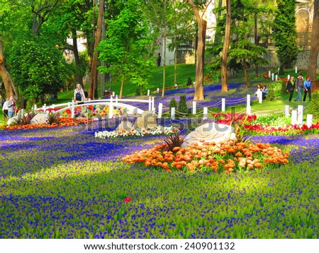 ISTANBUL, TURKEY -- CIRCA APRIL 2014: Tourists walk among the sculptures in the lush Gulhane Park                                - stock photo