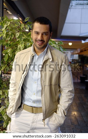 ISTANBUL, TURKEY - DEC 4:  Famous Turkish pop singer Emre Altug on December 4, 2006 in Istanbul, Turkey.
