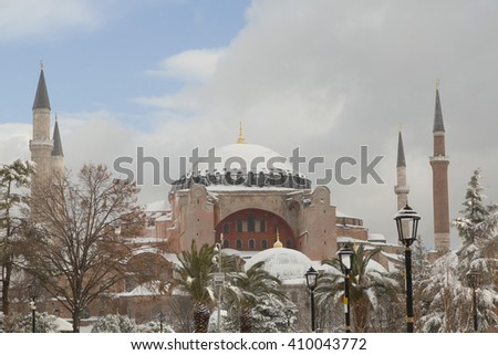 ISTANBUL,TURKEY - DEC 31 : Tourists visiting the Hagia Sophia in front of Sultan Ahmed Park on Dec 31,2015 in Istanbul, Turkey. Hagia Sophia is the greatest monument of Byzantine Culture.