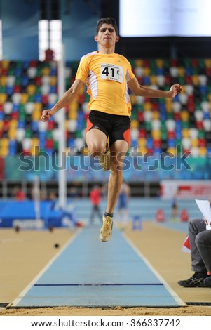 ISTANBUL, TURKEY - DECEMBER 26, 2015: Athlete Emre Guntekin long jumpes during Turkish Athletic Federation Indoor Athletics Record Attempt Races